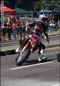 racing on a motorbike